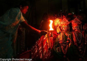 A Devadasi woman worships the goddess, Yellamma. Photo Credit: Julia Cumes